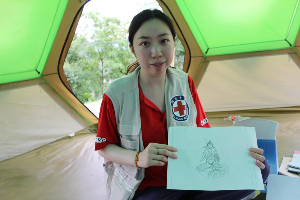 Clinical psychologist Eliza Cheung works with affected families to teach them about the critical role mental health plays following a traumatic experience. By Niki Clark ©IFRC